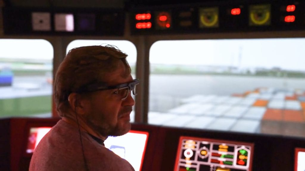 man with eye tracking glasses in an airplane simulator cabin