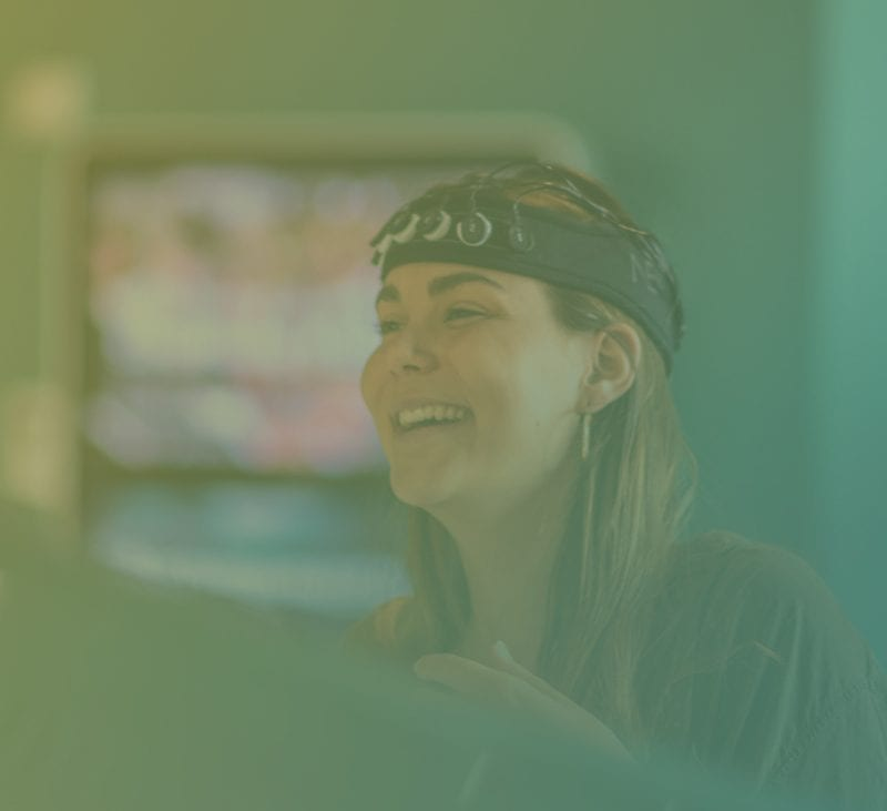 Participant wearing EEG and smiling