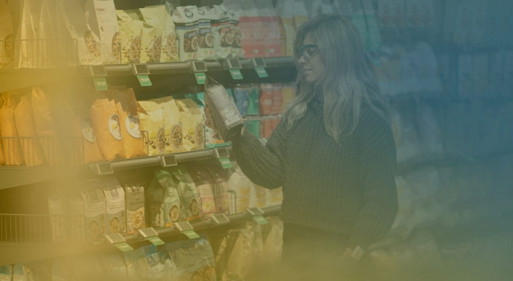 Girl choosing granola in a supermarket wearing eye tracking glasses and GSR