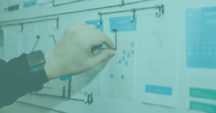 Hand fixing users navigation journey on a white board