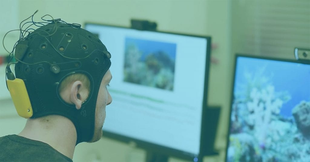 Participant in experiment wearing EEG