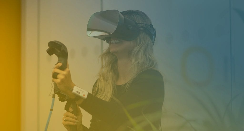 Girl using Varjo VR device