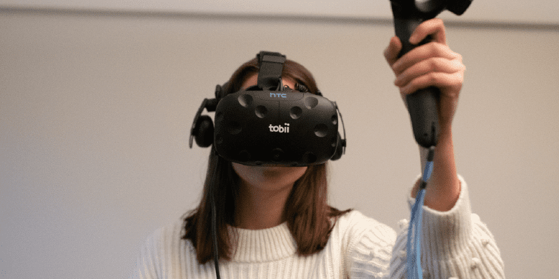 woman using a Tobii HTC Vive VR headset