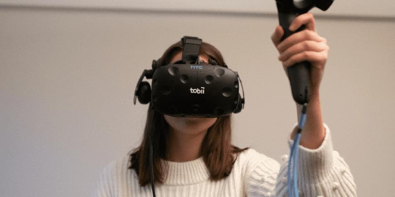 woman using a Tobii HTC Vive VR headset