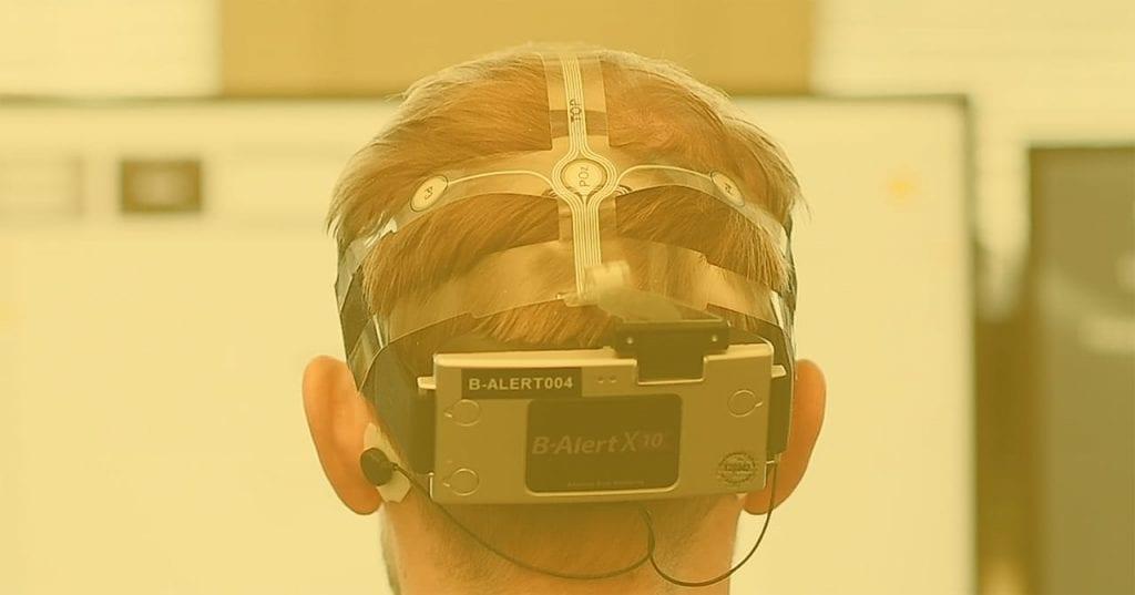 closeup of the back of a head wearing a B-Alert X10 EEG headset