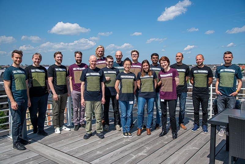 iMotions development team on rooftop in matching t-shirts