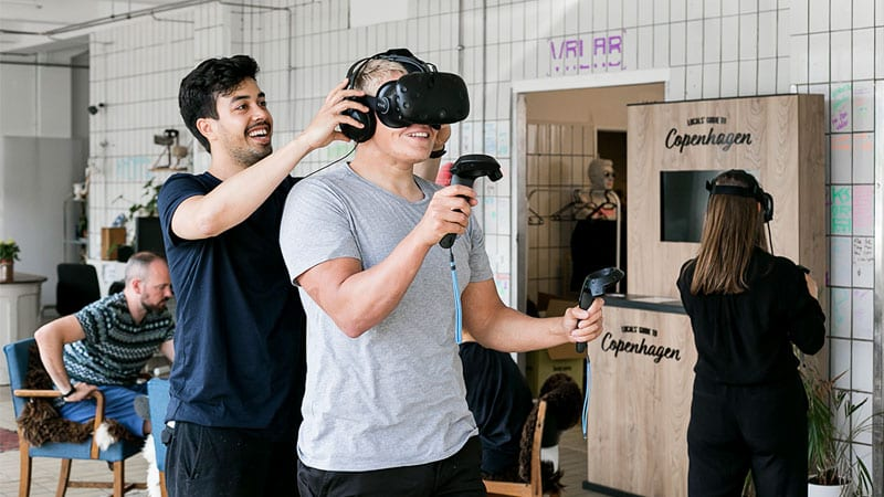 customer trying a headset at Khora VR studio